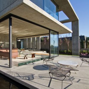 Ample Seating Space In The Patio And Open Living Room Design