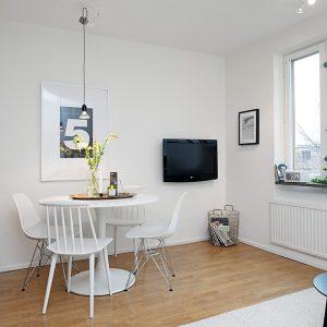 Bright White Interior And Simple White Dining Space With White Wall And Wooden Flooring