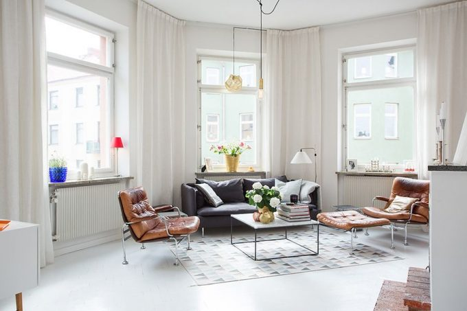 Bright Living Room Of The Swedish Apartment With Black Sofa And Leather Longe Chair