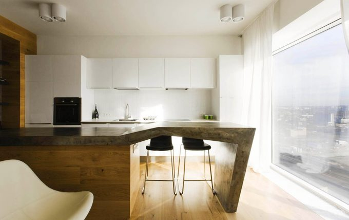 Clean Lined Kitchen With Concrete Kitchen Island Design