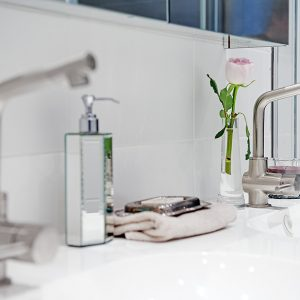 Details Of Bathroom Vanity With Modern Stainless Steel Faucet