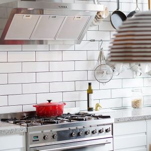 Hints Of Red Accents In The Kitchen Through Cookware Minimalist Kitchen For Small Apartment