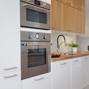Kitchen Details With White Cabinets And Modern Kitchen Appliances
