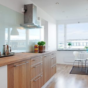 Kitchen View With Bright Lighting Large Glass Window And Glass Walls