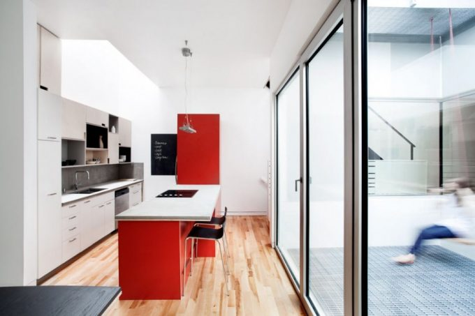 Kitchen White And Red Color In Minimalistic Design And Floor To Ceiling Glass Door