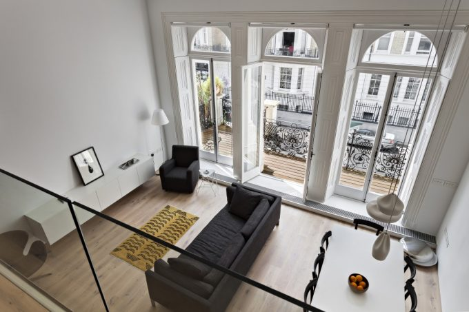 Lovely View High Ceilings With Glass Banister