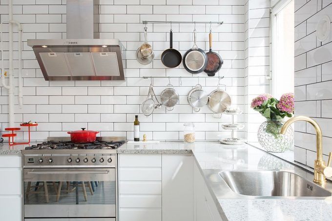 Marble Kitchen Countetops Complement The Pristine White Walls Compact Kitchen Design
