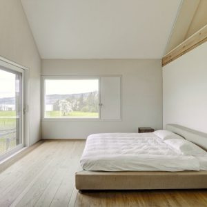 Minimalist Bedroom With White Interior Simple Bright Bedroom And Floor To Ceiling Windows