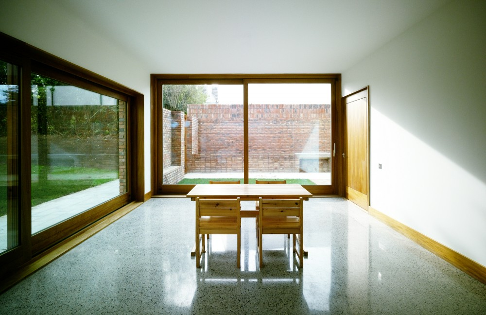 Minimalist Wooden Details as Your Home Inspiration: Minimalist Decor Open Dining Room Design With Sliding Door