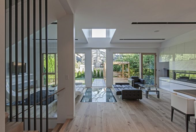 Open Space Living Room Design With Glass Wall And Glass Floor