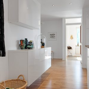 View Throughout The House White Corridor With Wooden Flooring