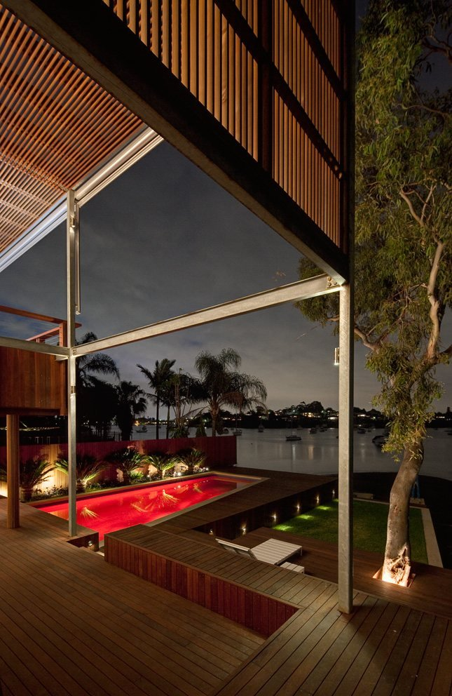 See the Beauty of Sidney Harbour from Multi-Level Home Concept: Wooden Warm Terracedesign With Red Pool Lighting
