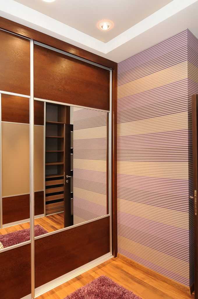 Beautiful Fresh Lined Wallpaper And Mirror Cabinet
