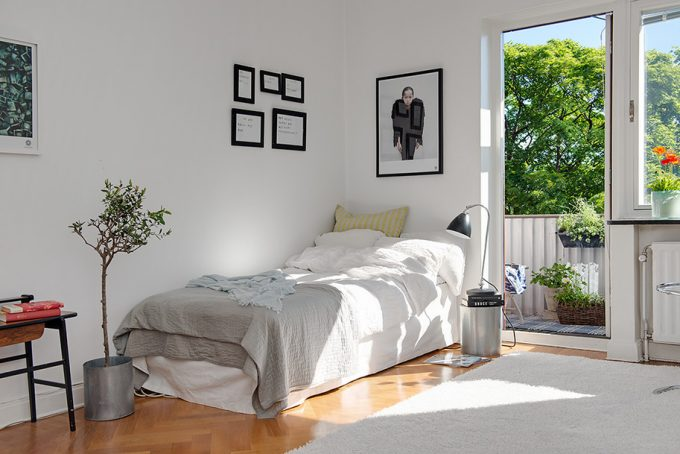 Bed Side With Single White Bed And White Wall