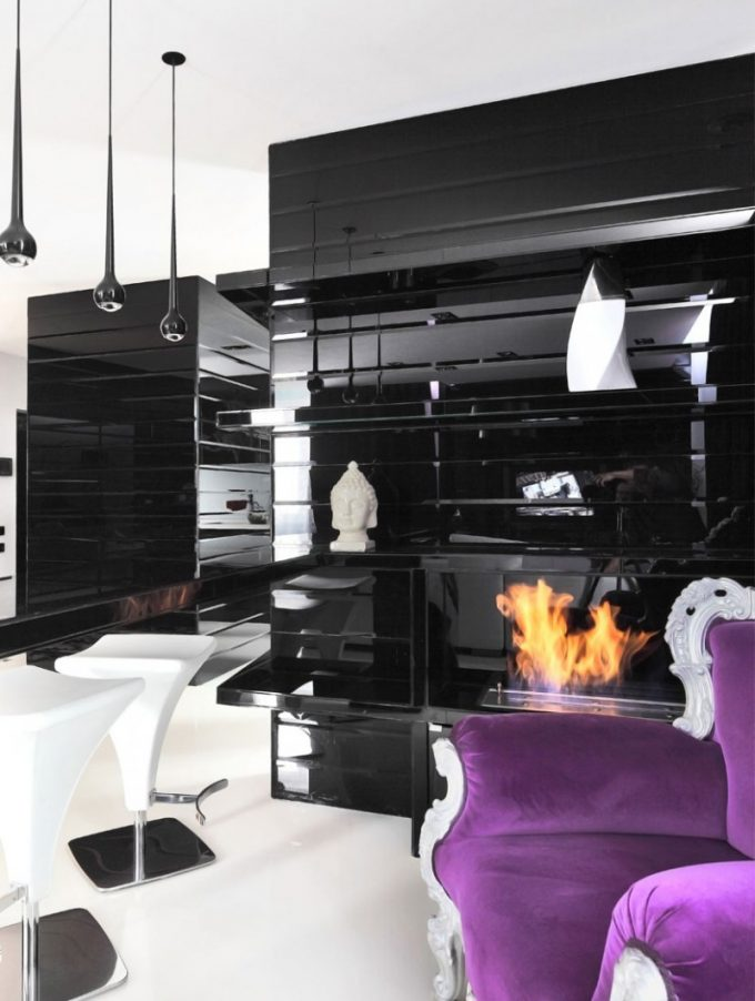 Black And White Interior Decor With Gas Fireplace And A Purple Couch Accent
