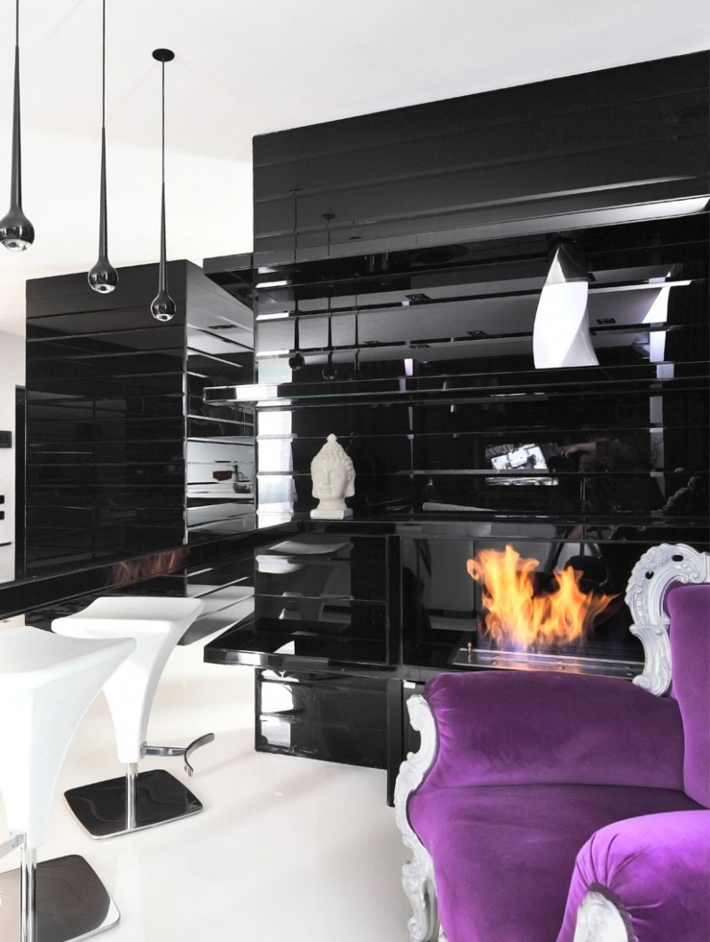Black And White Interior Decor With Gas Fireplace A Purple Couch Accent