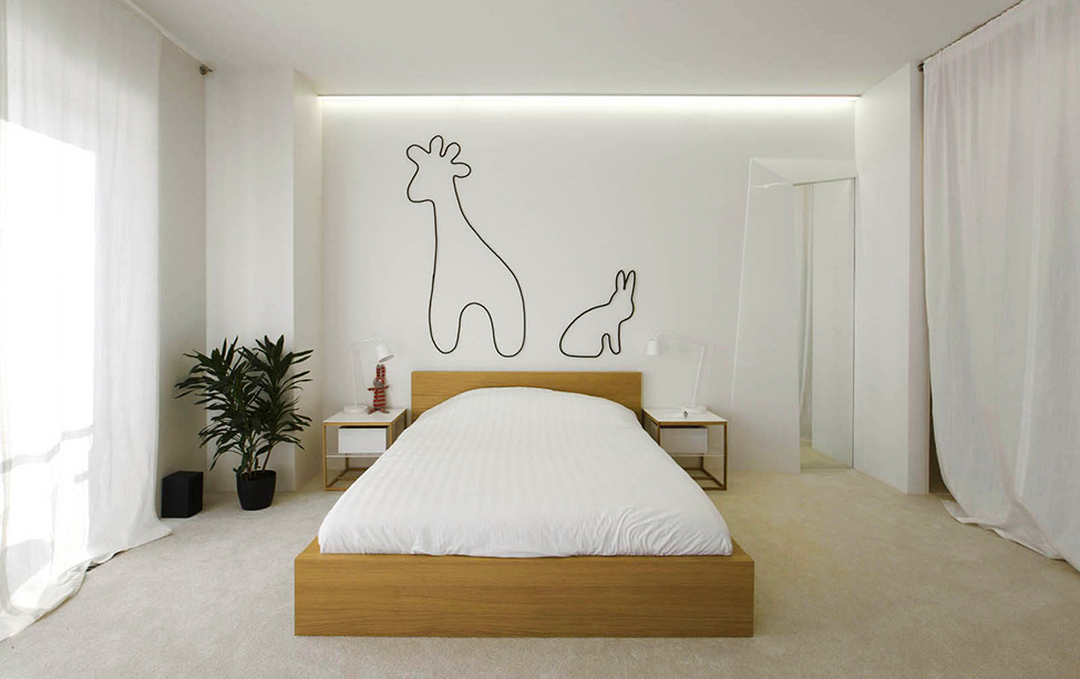 Clean Neat White Bedroom With Simple Animal Wallpaper Decor And White Curtain Window