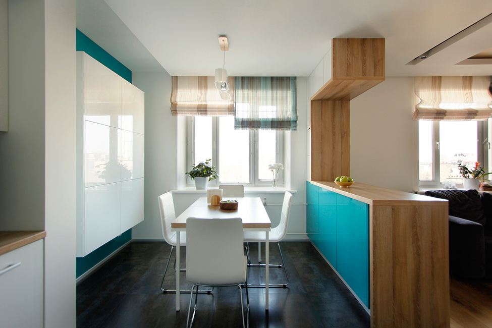 Colorful Kitchen Space With White Cabinet And Black Floor