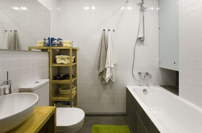 Compact White Bathroom With White Bathtub And Sink Also Towel Storage