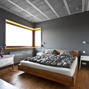 Contemporary Bedroom Design With Grey Wall And Minor Yellow Accent