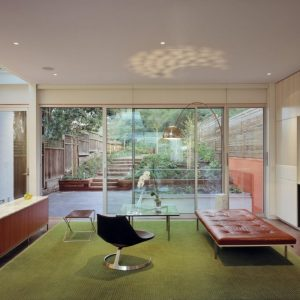 Cozy Lounge Room Decor Wih Large Glass Walls And Green Landscaping