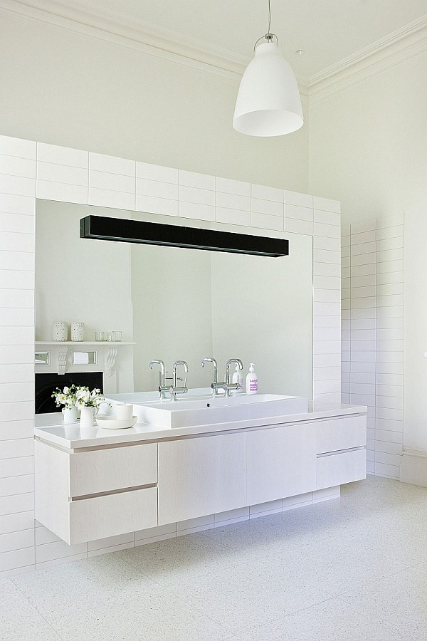 Elegant Clean White Bathroom With White Vanity And Mirror