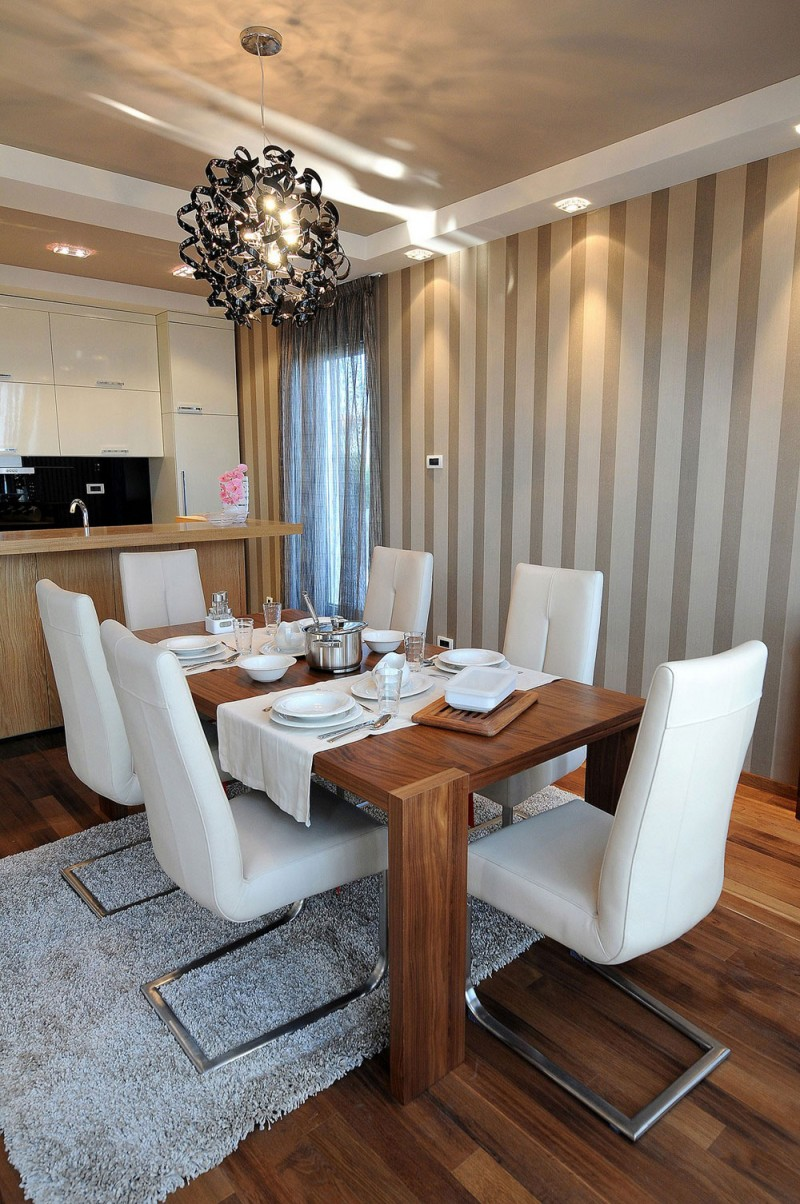 Formal Dining Room Design With Wooden Table And Stylish White Chair