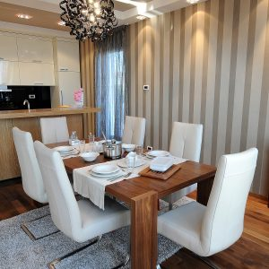 Formal Wooden Dining Table With 6 Modern White Chair Unique Pendant Lamp