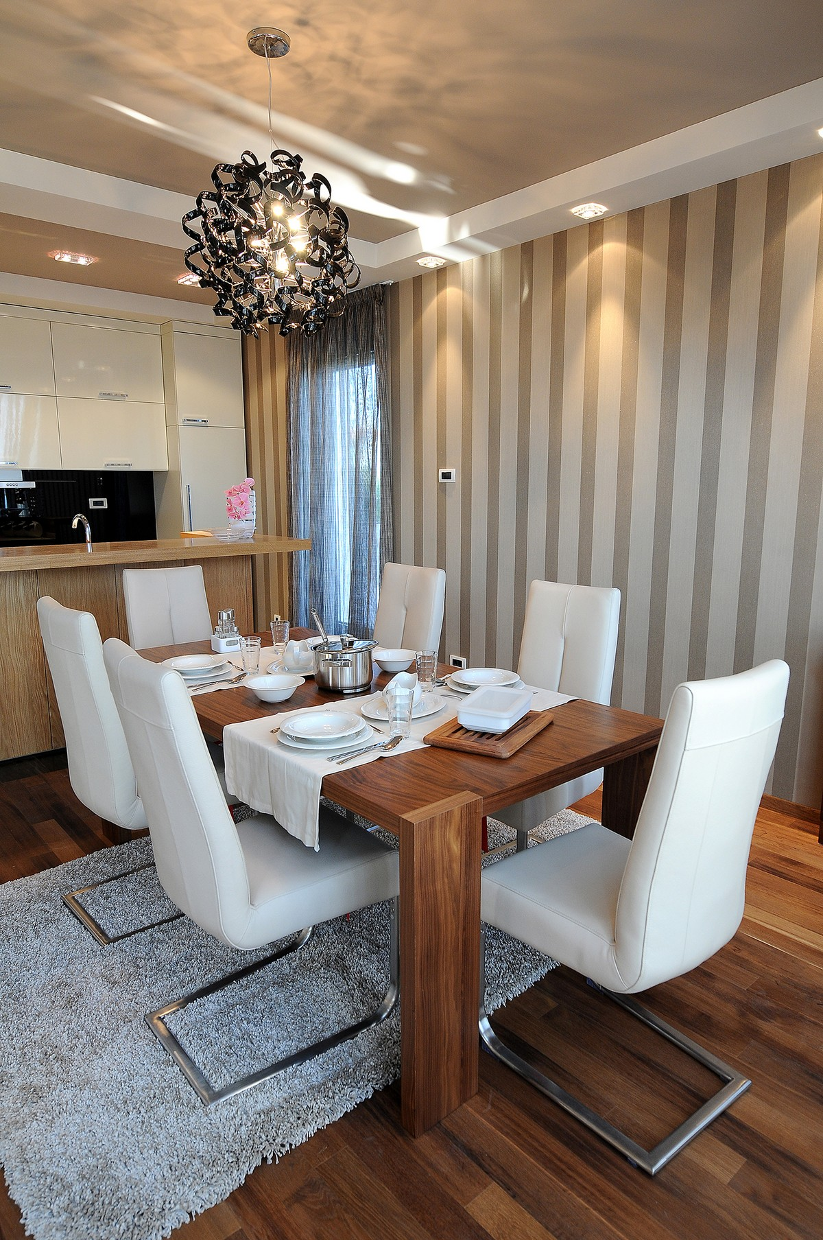 Luxurious Penthouse in Modern and Comfort Design: Formal Wooden Dining Table With 6 Modern White Chair Unique Pendant Lamp