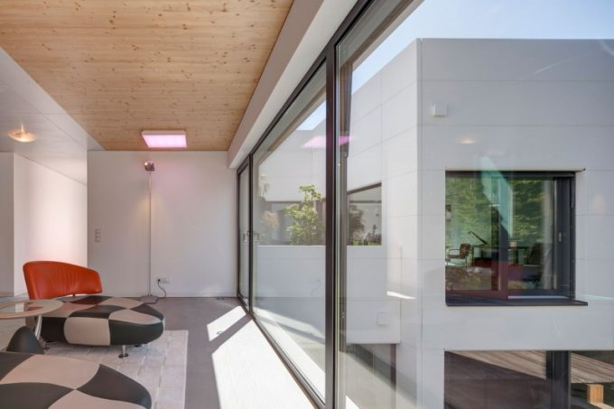 Glass Wall Used For Natural Light Exposure To The Contemporary Living Space