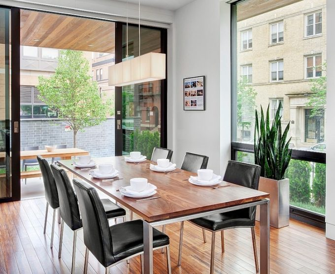 Glass Walls And Sliding Glass Door Design In Comfort Dining Room