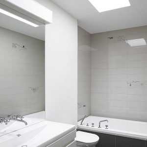 Grey And White Bathroom Design With White Bright White Lighting System