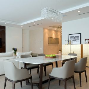Laminated Floor Apartment Interior And Beautiful Crystals Chandelier