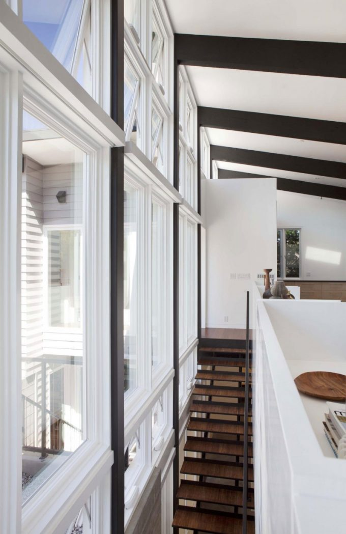 Large Windows And Wooden Stair 2 Story Energy Efficient House Design