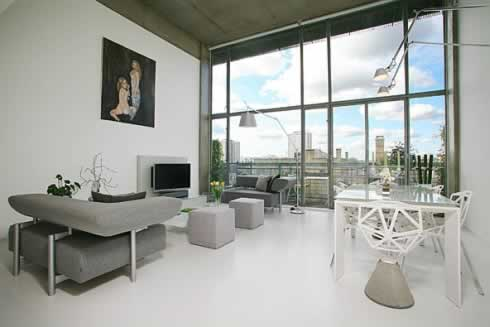 Living Urban Loft Spaces With Modern Grey Sofa And Simply Furniture