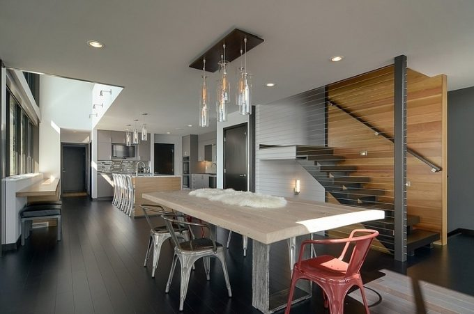 Luxury Dining Space And Contemporary Kitchen Area With Laminated Black Flooring
