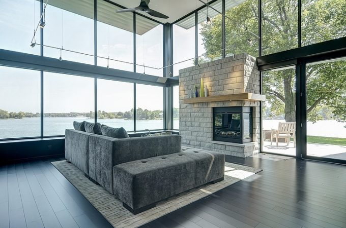 Luxury Grey Sofa And Modern Fireplace With Glass Walls Lounge Space Decor