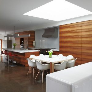 Modern Kitchen Design With Wooden Countertop And White Dining Table