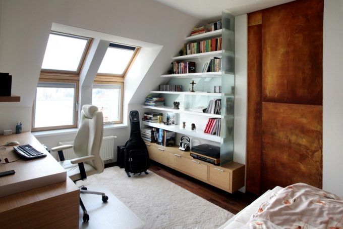 Modern Work Space With Classy Chair And Book Shelves