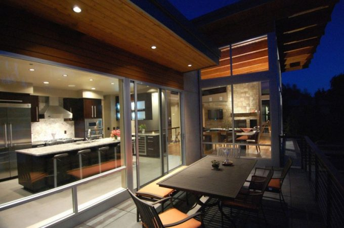 Night Facade Of Patio With Wooden Furniture