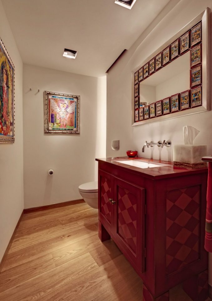 Powder Room Decor With Red Cabinet And Wall Mural Decor