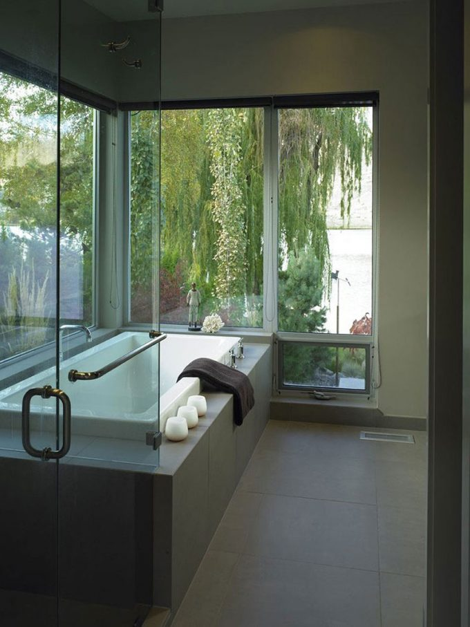 Relaxing Bathroom Decor With White Bathtub And Large Window And Green View