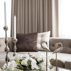 Silver Chandelier And Dolpin For Living Room Decor And Neutral Color Curtain