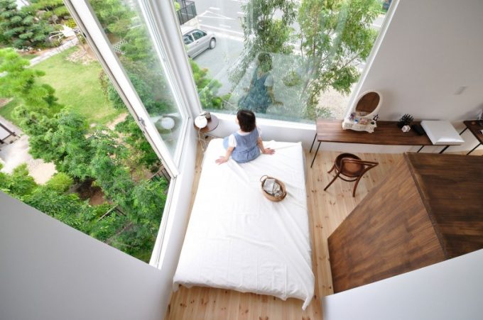 Simple Bedroom Design With Large Glass Window To See The Greenery