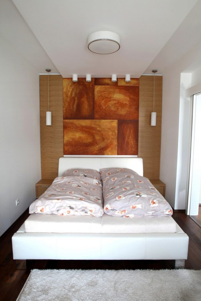 Small Bedroom Design With White Bed And Art Painting Headboard