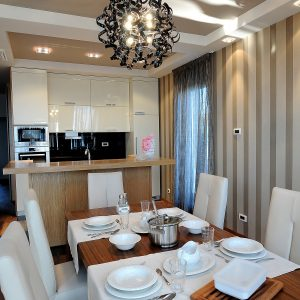Small Contemporary Kitchen Dsign With White Glossy Cabinet And Wooden Kitchen Island
