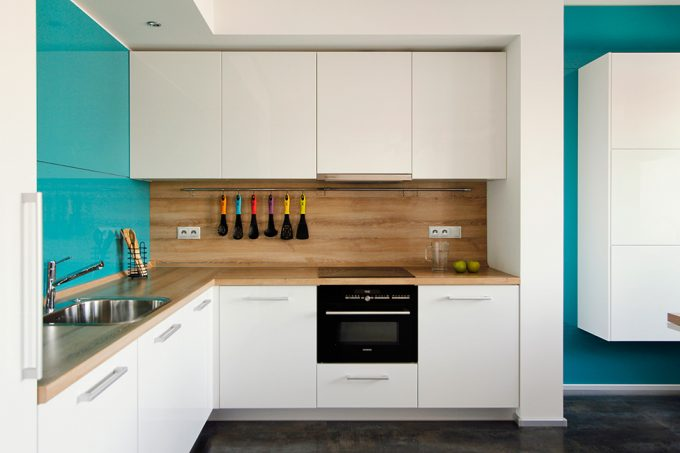 Small Kitchen Countertop With White Kitchen Cabinet And Blue Wall