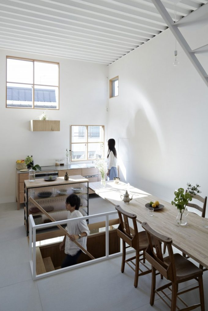 Small Kitchen Design With Window And White Wall