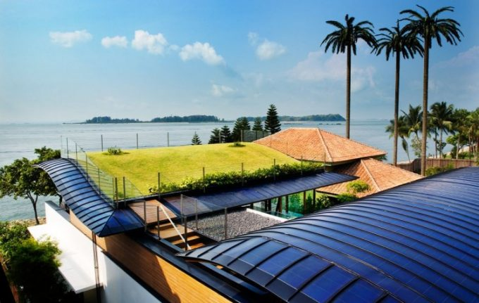 Solar Panel To Supply Energy To The House And Green Grass Roof Design