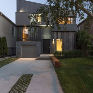 Spacy Courtyard And Garage With Green Landscaping